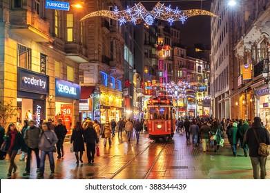 ISTANBUL, TURKEY - February 22: Nostalgic tramway on the main pedestrian Taksim Istiklal Street at late evening on February 22, 2015 in Istanbul, Turkey