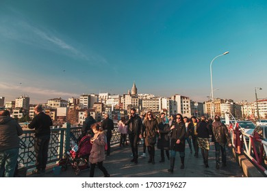 Istanbul, Turkey February 23, 2020: General view from Galata Bridge, people are walking with background of Galata Tower