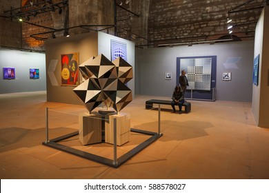 Istanbul, Turkey - FEBRUARY 27, 2017: Visitors in Tophane-i Amire, a modern exhibition hall, former cannon foundry. Victor Vasarely Retrospective exhibition.