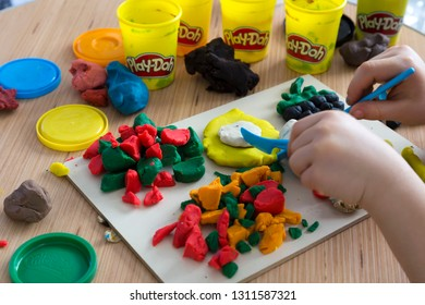 Istanbul/ Turkey - February 8, 2019 ; step by step making object with colorful play dough or Playdoh for children's activity. school,nursery or kindergarten lesson plasticine concept.