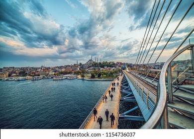 ISTANBUL, TURKEY: Golden Horn Metro bridge in Istanbul, Turkey and view of Suleymaniye mosque after sunset on April 17, 2018