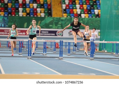 ISTANBUL, TURKEY - JANUARY 07, 2018: Athletes running 60 metres hurdles during Turkish Athletic Federation Olympic Threshold Indoor Competitions