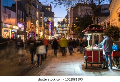 ISTANBUL, TURKEY - JANUARY 1, 2018: Taksim Istiklal Street at evening. Taksim Istiklal Street is a popular destination in Istanbul, Turkey.