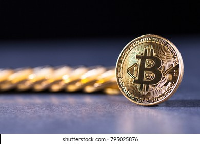 Istanbul, Turkey - January 13, 2018: Photo Golden Bitcoins (new blockchain ) Close-up on a purple background.