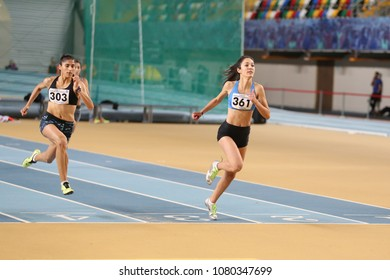 ISTANBUL, TURKEY - JANUARY 14, 2018: Athletes running 60 metres hurdles during Turkish Athletic Federation Olympic Threshold Indoor Competitions