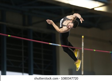 ISTANBUL, TURKEY - JANUARY 14, 2018: Undefined athlete pole vaulting during Turkish Athletic Federation Olympic Threshold Indoor Competitions