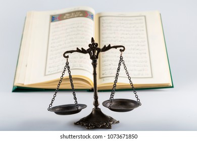 Istanbul / Turkey - January 18, 2018 ;Holy book for Muslims.Koran and scales on the white background.