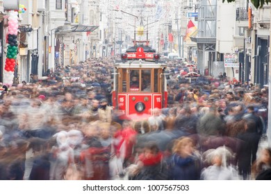 Istanbul, Turkey; January 20, 2018: Massive crowd of people view from Istiklal Street with the long exposure and tramway