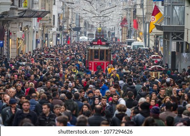 ISTANBUL, TURKEY - JANUARY 20, 2018: Historic Red Tram on Istiklal Street where the most popular destination of Istanbul for shopping and entertainment.