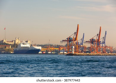 Istanbul, Turkey - January 22, 2015 : Cranes and freight vessel in Haydarpasa port.The harbor gives loading and unloading services to the vessels.