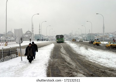 ISTANBUL, TURKEY - JANUARY 23: People trying to go to work on a snowy day in Eminonu District on January 23, 2007 in Istanbul, Turkey.