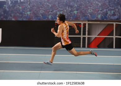 ISTANBUL, TURKEY - JANUARY 26, 2021: Undefined athlete running during Turkish Athletic Federation Olympic Threshold Competitions