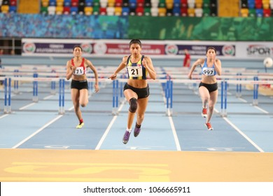 ISTANBUL, TURKEY - JANUARY 28, 2018: Athletes running 60 metres hurdles during Turkcell Turkish U20 Indoor Athletics Championships