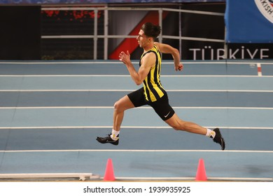 ISTANBUL, TURKEY - JANUARY 30, 2021: Undefined athlete running during Turkish Athletic Federation Olympic Threshold Competitions