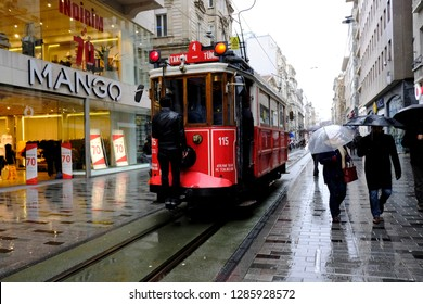 Istanbul, Turkey - January 5, 2019. A red tram goes on Istiklal street of Istanbul as people walk in the street