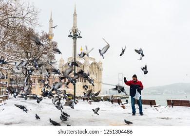 ISTANBUL, TURKEY - JANUARY 8, 2017: Snowy day in Ortakoy, Istanbul, Turkey. View of Ortakoy Mosque and Bosphorus Bridge.