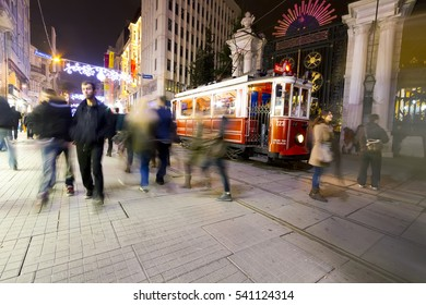 ISTANBUL, TURKEY - JULY 08, 2016 : The Taksim Tunel Nostalgia Tram trundles along the istiklal street and people at istiklal avenue