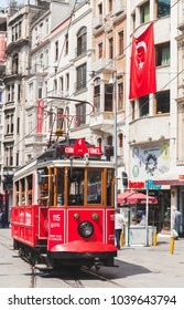 Istanbul, Turkey - July 1, 2016: Traditional red tram goes on Istiklal street in Istanbul, popular public and tourist transport, ordinary people walk on street
