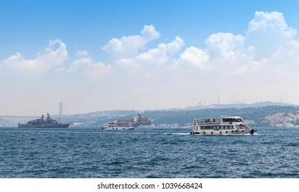 Istanbul, Turkey - July 1, 2016: Passenger, military and cargo ships go in Bosporus strait