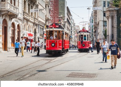 Istanbul, Turkey - July 1, 2016: Vintage red tram goes on Istiklal to Taksim square in Istanbul, ordinary people and tourists walk on the street
