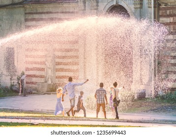 ISTANBUL, TURKEY - JULY 10, 2014: children and adults having fun in water at hot day at Topkapi palace in Istanbul, Turkey.