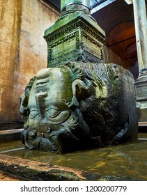 Istanbul, Turkey - July 10, 2018. Upside-down head of Medusa located at the northwest edge of the subterranean Basilica Cistern, also known as Yerebatan Sarnici. Istanbul, Turkey.