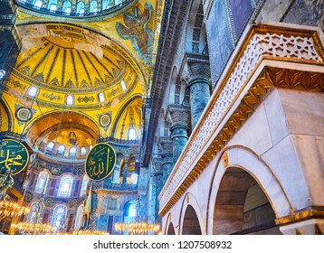 Istanbul, Turkey - July 10, 2018. The South Aisle of the Nave of the Hagia Sophia mosque and the Apse with the mosaic of the Virgin Mary in the background.