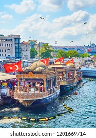 Istanbul, Turkey - July 11, 2018. The Fish Sandwich Boats moored in Eminonu Pier at the mouth of the Golden Horn Bay in the Bosphorus. Istanbul, Turkey.