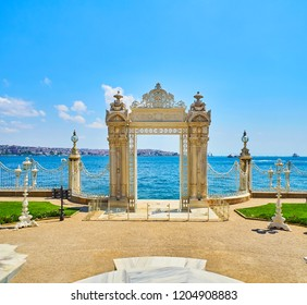 Istanbul, Turkey - July 11, 2018. The Gate to the Bosphorus of the Dolmabahce Palace, located in the Besiktas district. View from the coastal facade. Istanbul, Turkey.