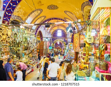 Istanbul, Turkey - July 11, 2018. Tourists at the passageways of the Kapali Carsi, The Grand Bazaar of Istanbul, Turkey.