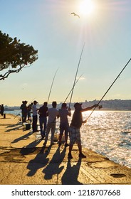 Istanbul, Turkey - July 11, 2018. Citizens fishing in the Bosphorus, with a view of the Istanbul skyline in the background. Turkey.
