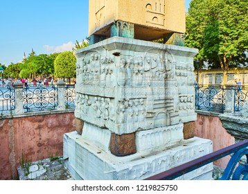 Istanbul, Turkey - July 11, 2018. Detail of the pedestal of The Obelisk of Theodosius, an ancient Egyptian obelisk in the Hippodrome of Constantinople. SultanAhmet Square. Istanbul, Turkey.
