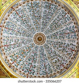 ISTANBUL, TURKEY - JULY 12, 2014: A floral designs in the ceiling decorations in the Hall with a Fountain in Harem of Topkapi Palace, Istanbul, Turkey
