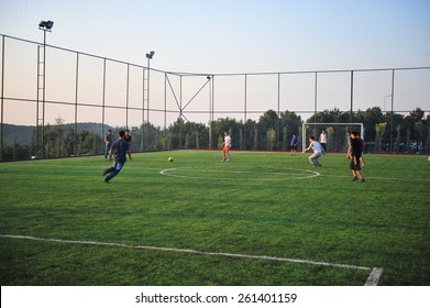 ISTANBUL ,TURKEY - JULY  12:  Students who play football in the astroturf July 12, 2012 in Istanbul, Turkey.