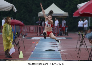 ISTANBUL, TURKEY - JULY 14, 2019: Undefined athlete long jumping during Balkan U18 Athletics Championships