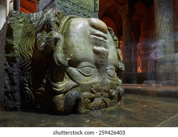 ISTANBUL, TURKEY - JULY 16, 2014: Medusa column bases in Basilica Cistern, Istanbul, Turkey. Yerebatan Saray is one of favorite tourist attraction in Istanbul.
