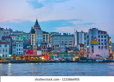 Istanbul, Turkey - July 18, 2018: Galata district and Karakoy quayside in Istanbul in the evening