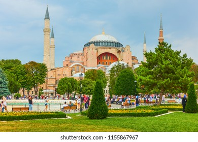 Istanbul, Turkey - July 18, 2018: People walk in park on Sultanahmet square, Turkey