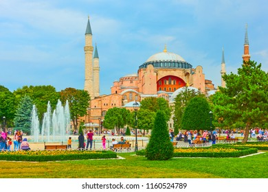 Istanbul, Turkey - July 18, 2018: City park with walking people in Sultanahmet square near The Hagia Sophia museum, Turkey