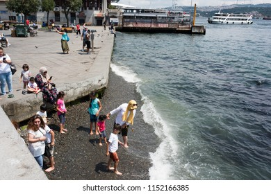 Istanbul, Turkey; July 21, 2018: people at the seaside on Besiktas
