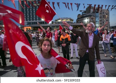 Istanbul - Turkey July 26,2016 People wave Turkish flags during a rally to protest the failed coup attempt at 15th July 2016 on Taksim Square.