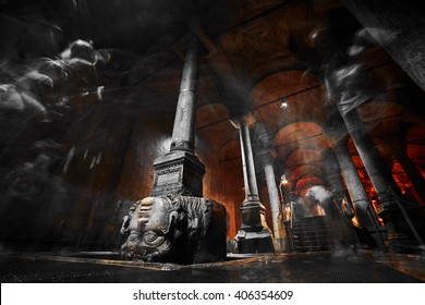 ISTANBUL, TURKEY - JULY 28, 2015: The Column with inverted Medusa head base in Basilica Cistern with blurred people.