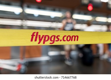ISTANBUL, TURKEY - July 28, 2017 : Yellow ribbon with logo of Pegasus Airlines at international Istanbul Ataturk Airport, flypgs.com - turkish airlines company