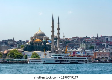 ISTANBUL, TURKEY – July 29 , 2018: Muslim architecture and water transport in Turkey - touristic landmarks from sea voyage on Bosphorus. Cityscape of Istanbul at sunset