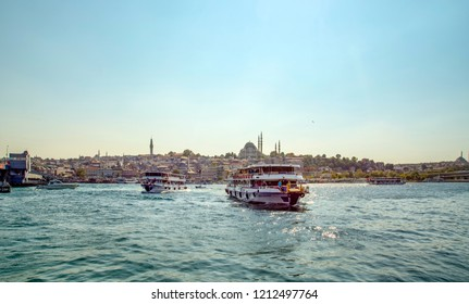 ISTANBUL, TURKEY – July 29 , 2018: Muslim architecture and water transport in Turkey - Beautiful View touristic landmarks from sea voyage on Bosphorus. Cityscape of Istanbul at sunset - old mosque