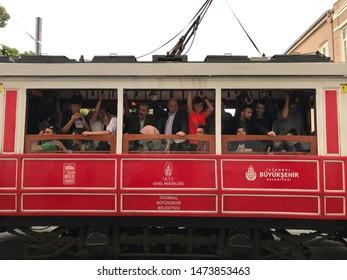 Istanbul, Turkey - July 29, 2019: People aboard the nostalgic tram in Istiklal Avenue in Beyoglu, Istanbul.