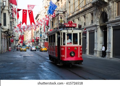 ISTANBUL, TURKEY - JULY 30, 2016: Retro tram on Istiklal street. Istanbul historic district. Istanbul famous touristic line. Red tram Taksim-Tunel.