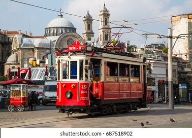 ISTANBUL, TURKEY - JULY 30, 2016: Retro tram on Taksim square. Istanbul historic district. Istanbul famous touristic line. Red tram Taksim-Tunel.