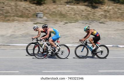 ISTANBUL, TURKEY - JULY 30, 2017: Athletes competing in cycling component of Istanbul Beylikduzu ETU Triathlon European Cup.