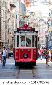 ISTANBUL, TURKEY - JULY 31, 2015 : Retro tram moves along a busy Istiklal street in Istanbul, Turkey